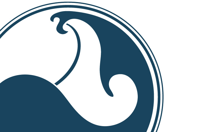 Close up of the Sacred Surf Logo